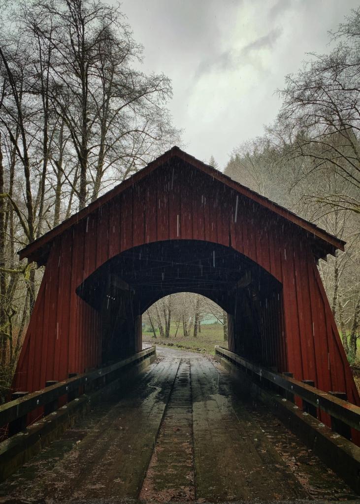 red covered bridge in the rain