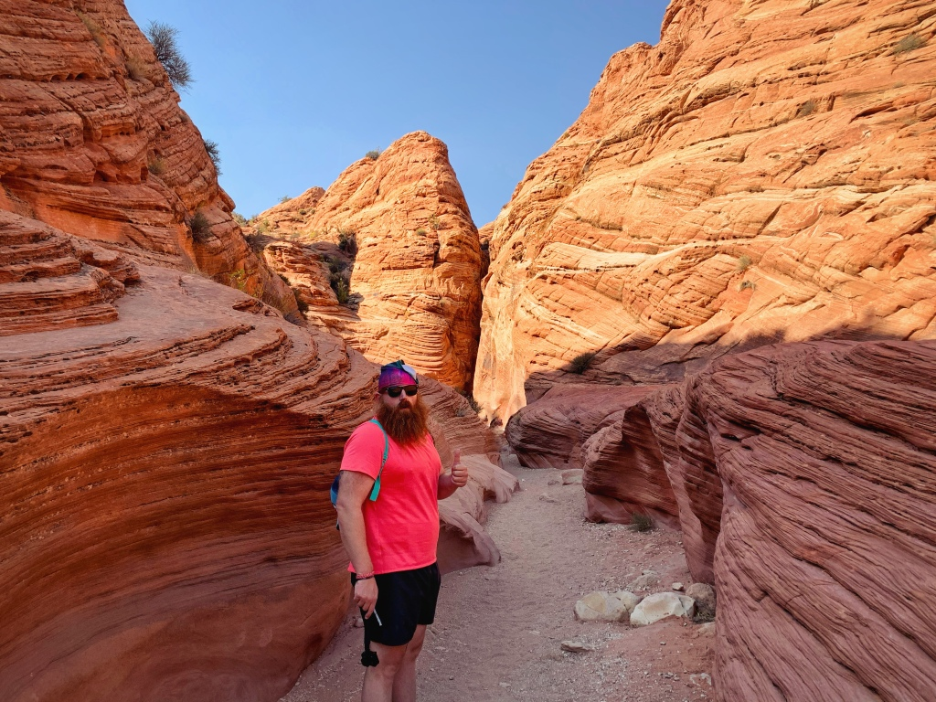 Man standing on trail in red rock canyon