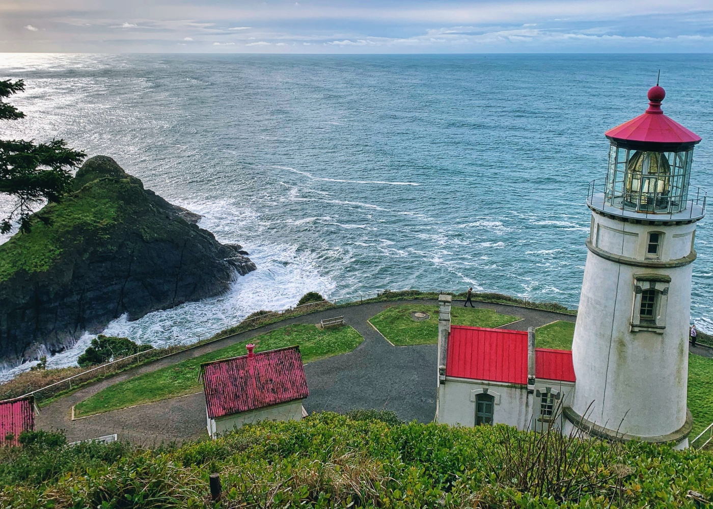 lighthouse on a cliff above the ocean