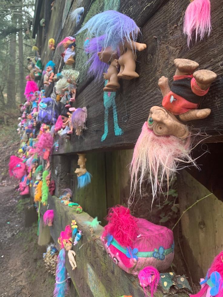 Colorful trolls pinned to Portland Troll Bridge