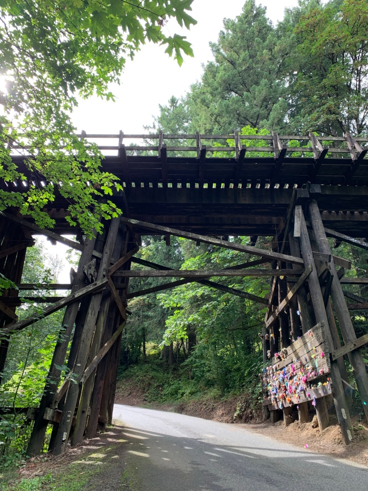 Troll toys nailed under railroad bridge