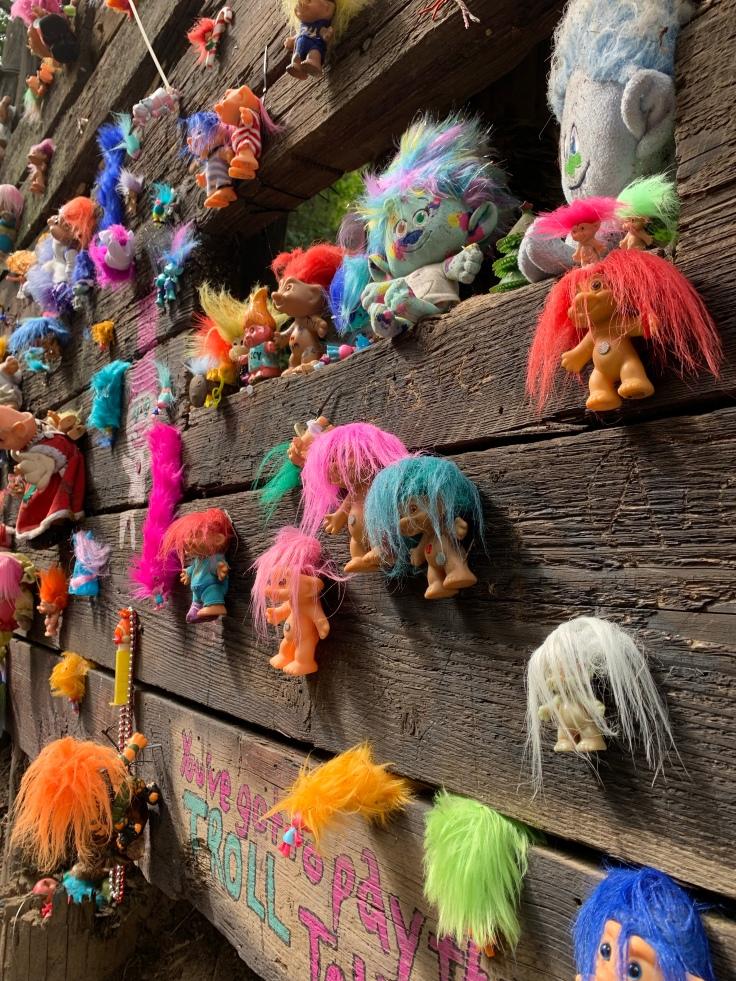 Colorful troll dolls on Portland troll bridge