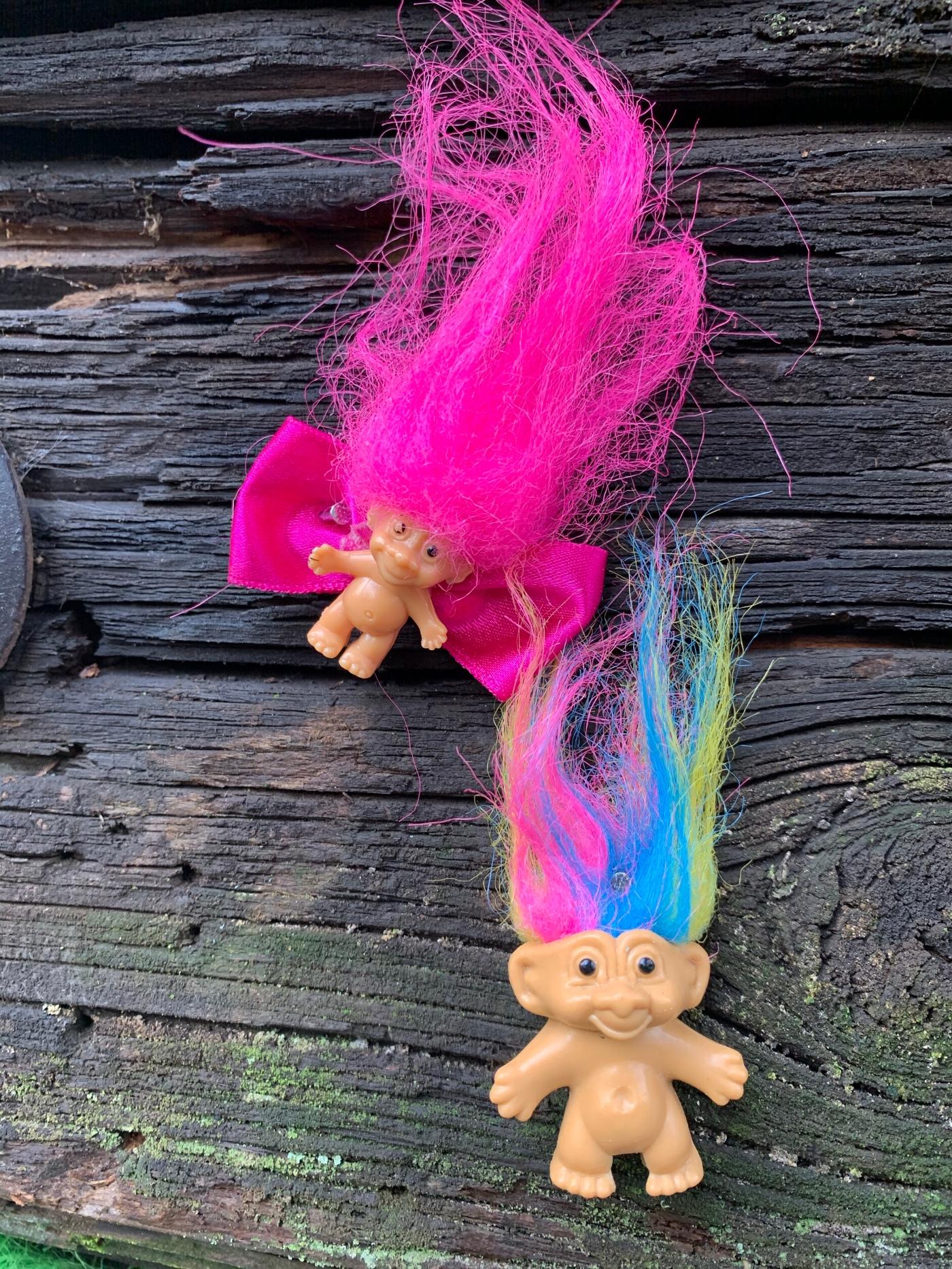 Troll toys nailed to Portland troll bridge