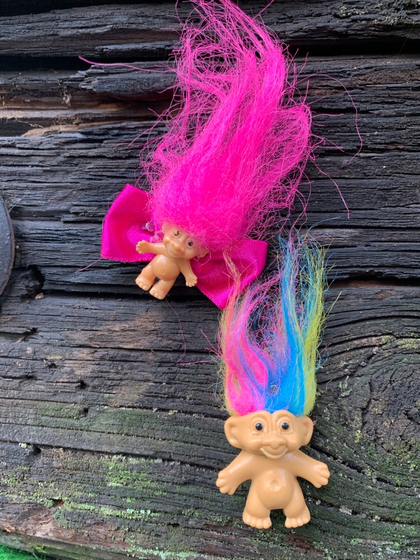 Troll toys nailed to Portland troll bridge