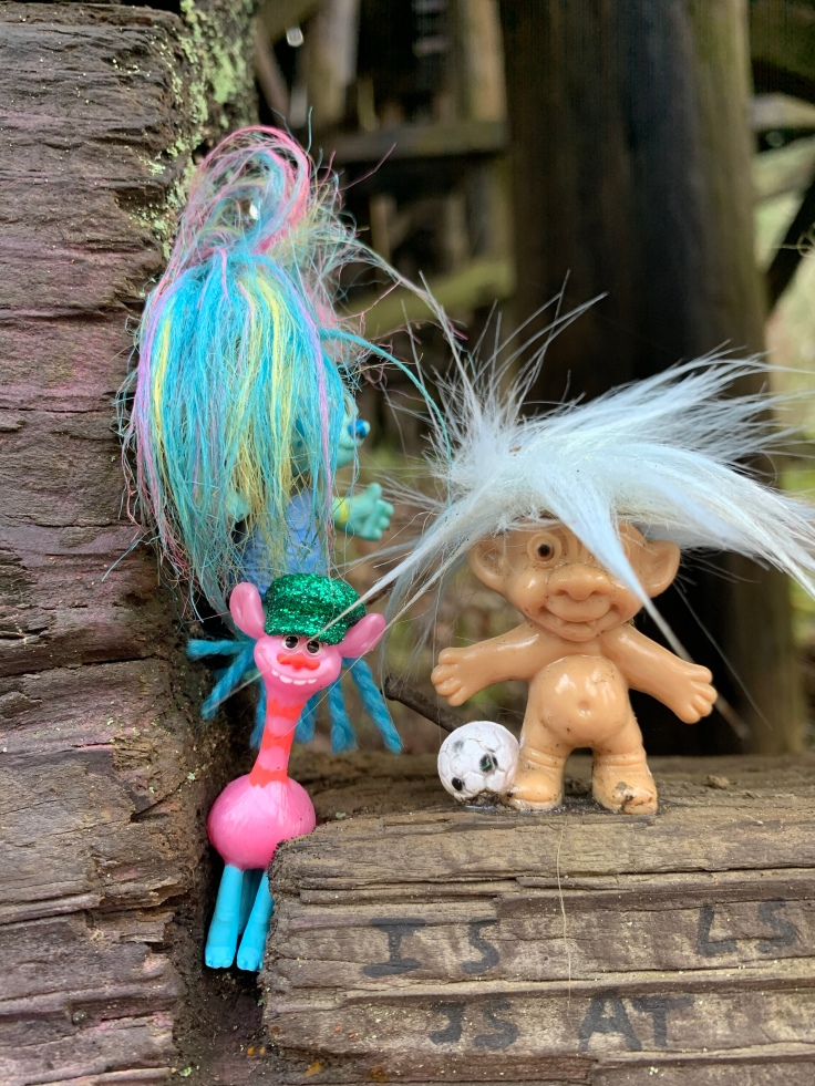 giraffe and soccer troll dolls at portland troll bridge