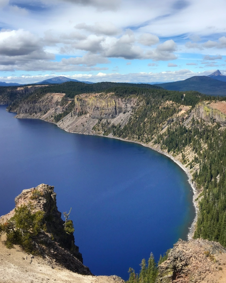 Bright blue water surrounded by cliffs in a crater lake
